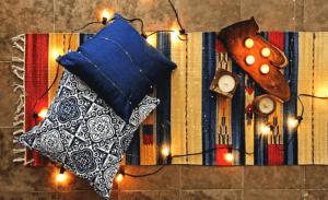 Boho rug pillows and string lights